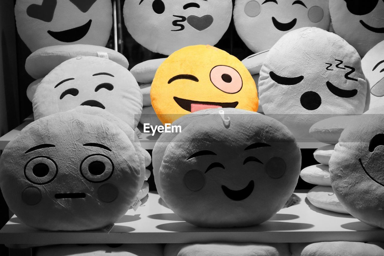 anthropomorphic face, anthropomorphic smiley face, indoors, large group of objects, no people, close-up, smiling, day, halloween