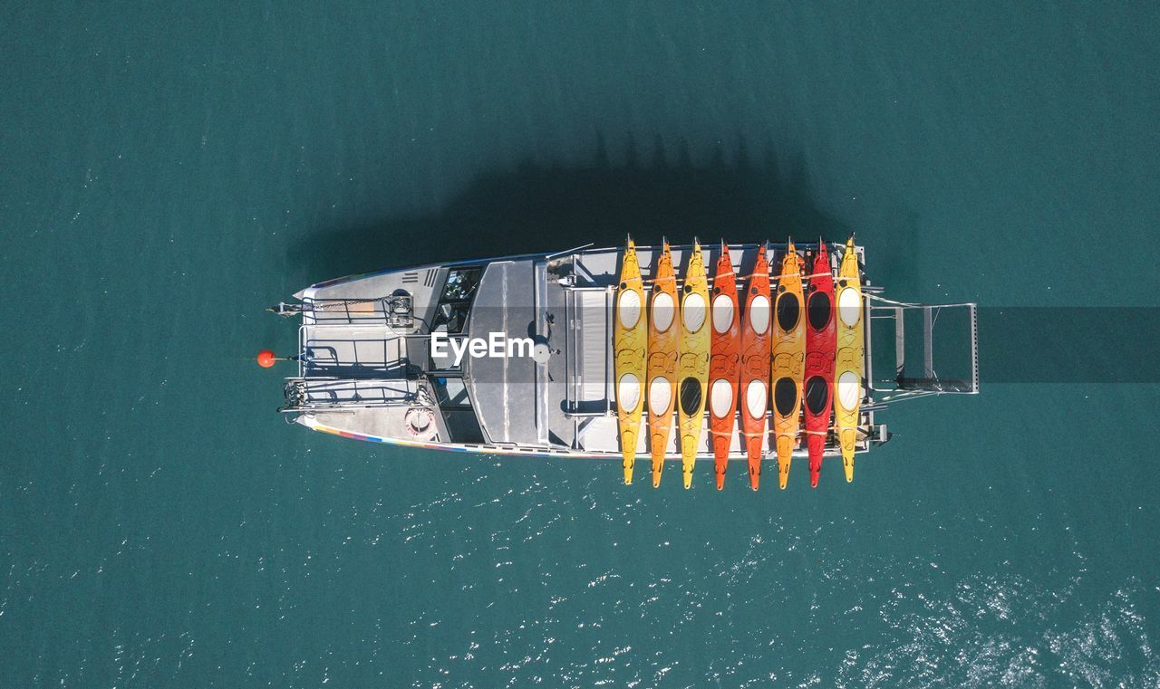 High Angle View Of Ship Moving On Sea During Sunny Day