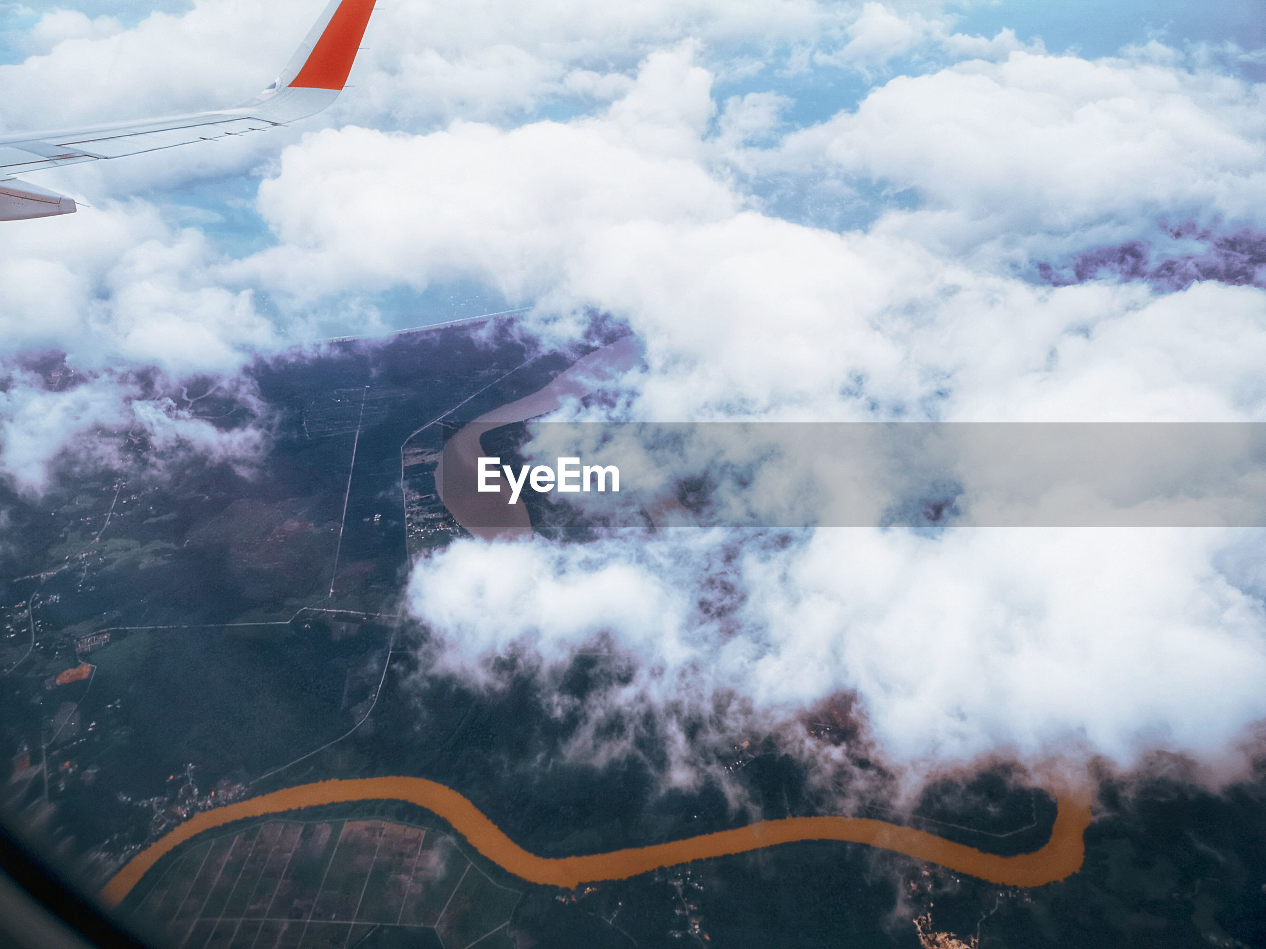 Aerial view of smoke emitting from airplane