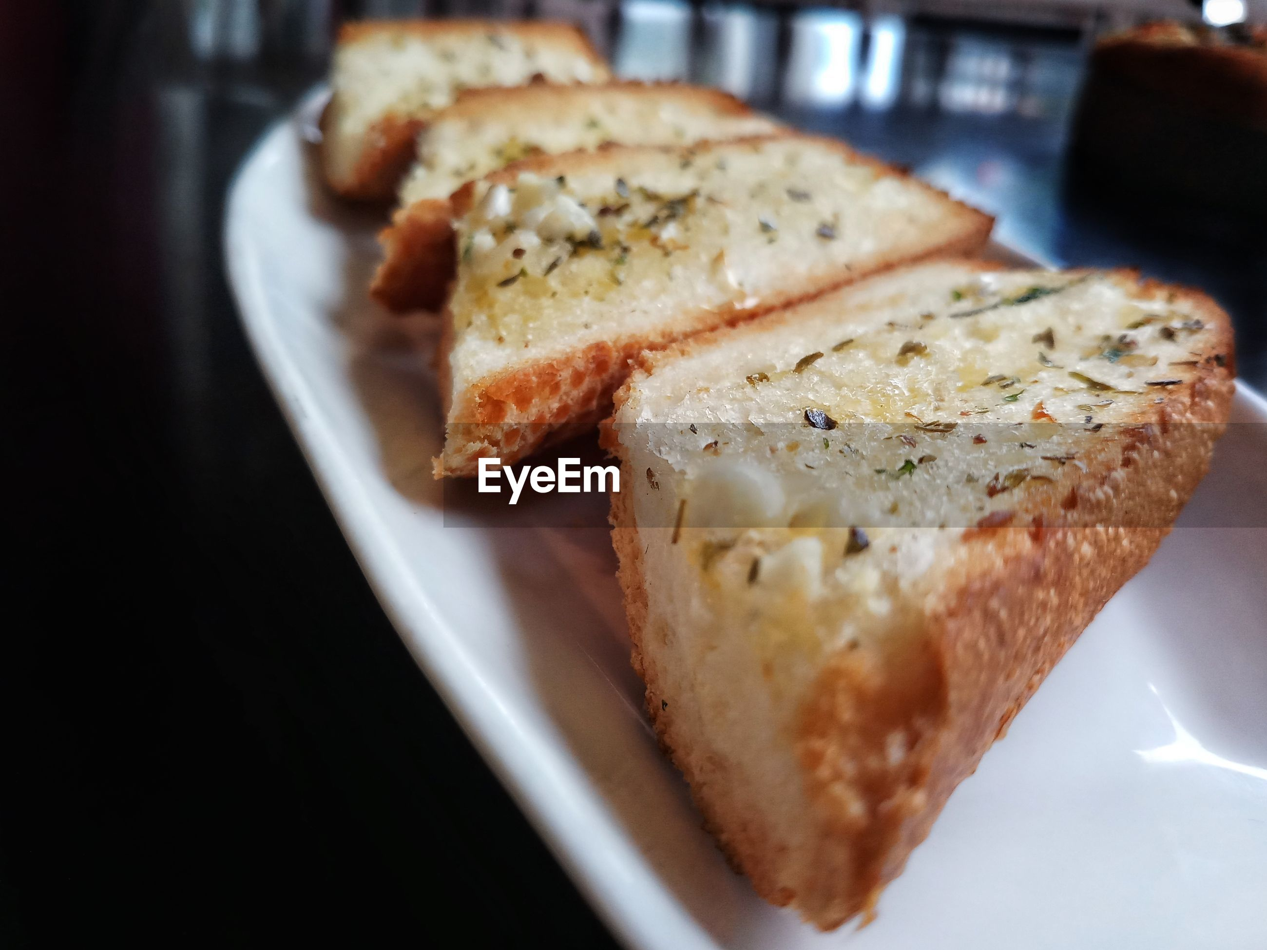 Close-up of breads in plate on table