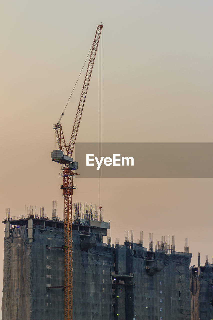 sky, machinery, crane - construction machinery, architecture, industry, built structure, construction industry, sunset, building exterior, development, no people, construction site, nature, water, outdoors, clear sky, incomplete, city, transportation, construction equipment