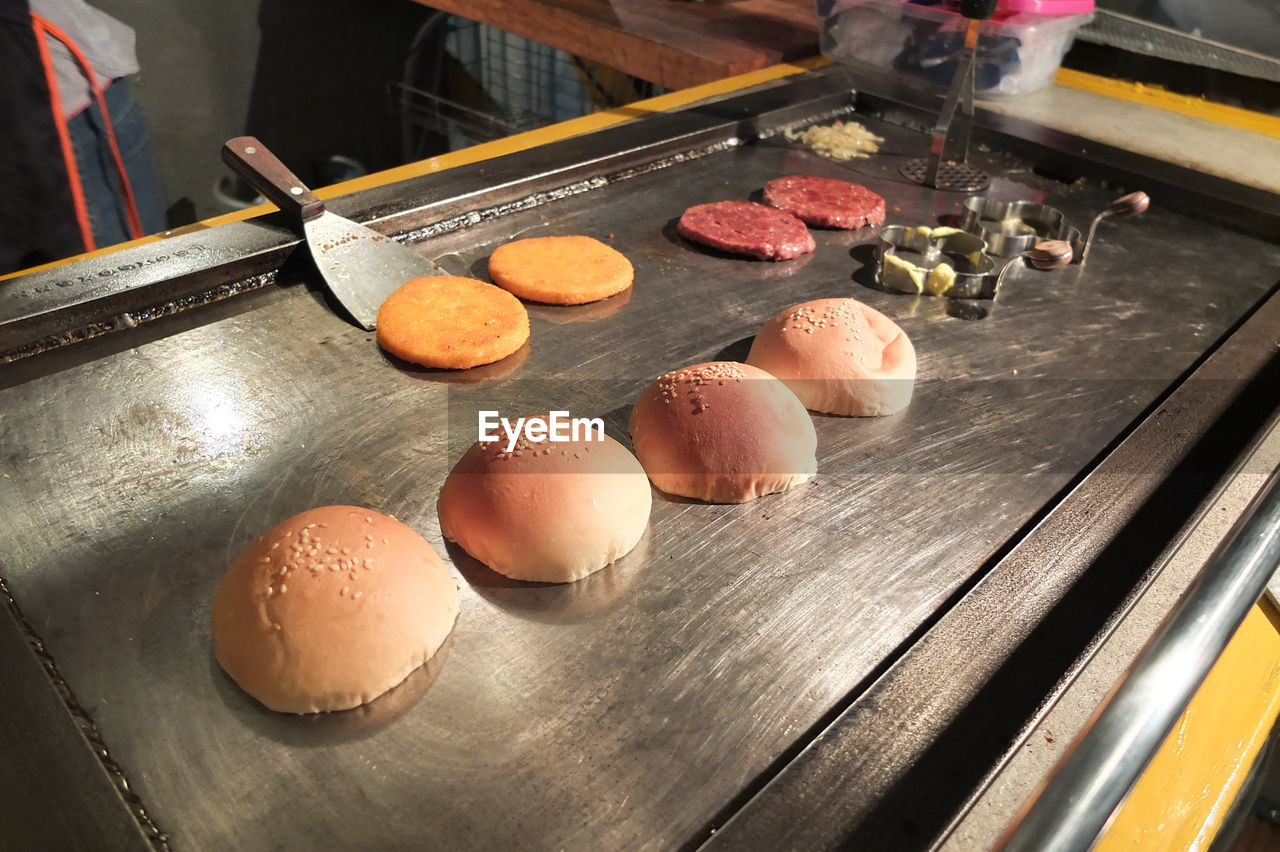 food and drink, food, freshness, indoors, preparation, high angle view, egg, still life, table, preparing food, kitchen, dough, healthy eating, kitchen utensil, wellbeing, raw food, rolling pin, no people, close-up, domestic room, tray, baking sheet, macaroon