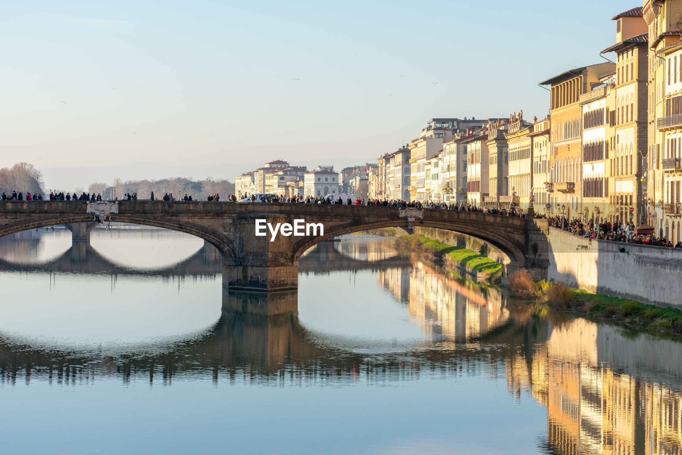 BRIDGE OVER RIVER WITH BUILDINGS IN CITY