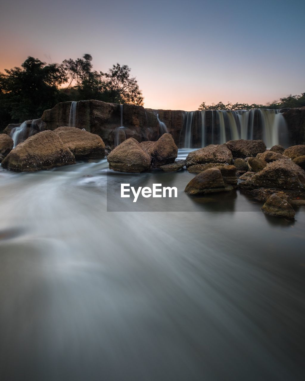 water, sky, scenics - nature, rock, long exposure, solid, beauty in nature, rock - object, tranquility, tranquil scene, nature, no people, motion, waterfront, sea, tree, sunset, blurred motion, land, flowing water, outdoors, power in nature, flowing
