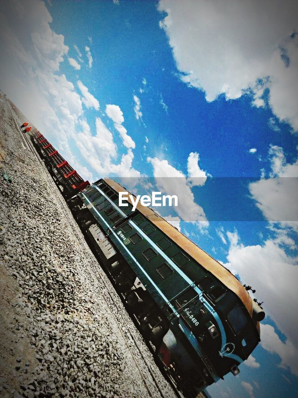sky, cloud - sky, transportation, rail transportation, day, low angle view, outdoors, no people
