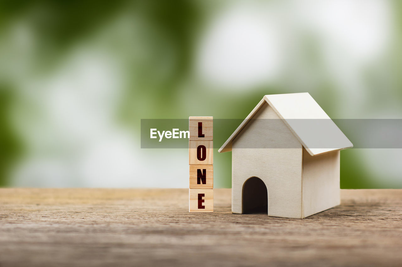 wood - material, built structure, architecture, selective focus, toy, toy block, house, home ownership, no people, building exterior, building, table, focus on foreground, close-up, model home, day, small, outdoors, still life