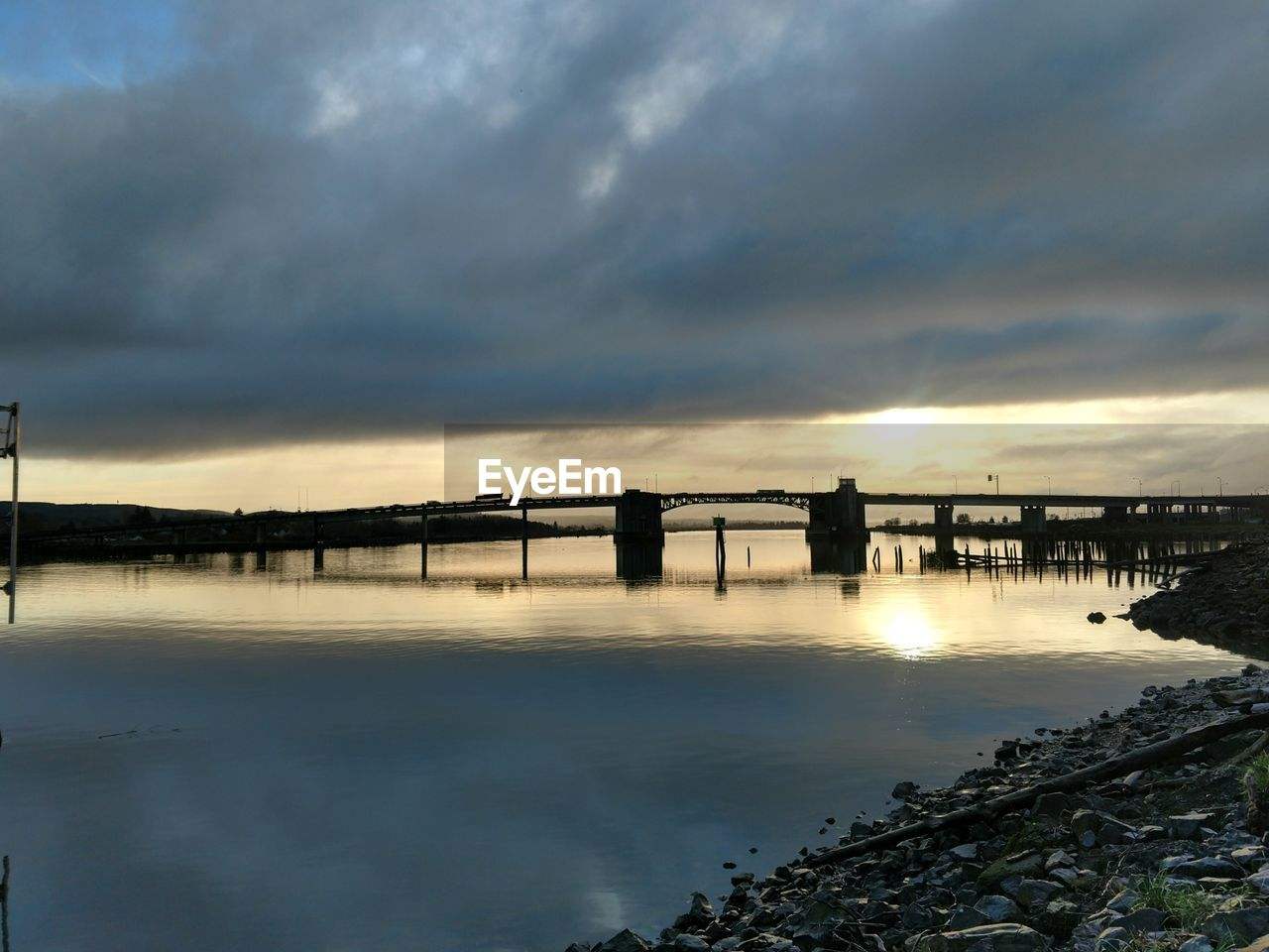 sunset, sky, cloud - sky, water, bridge - man made structure, connection, silhouette, nature, scenics, tranquility, outdoors, built structure, architecture, no people, tranquil scene, beauty in nature, sea, day