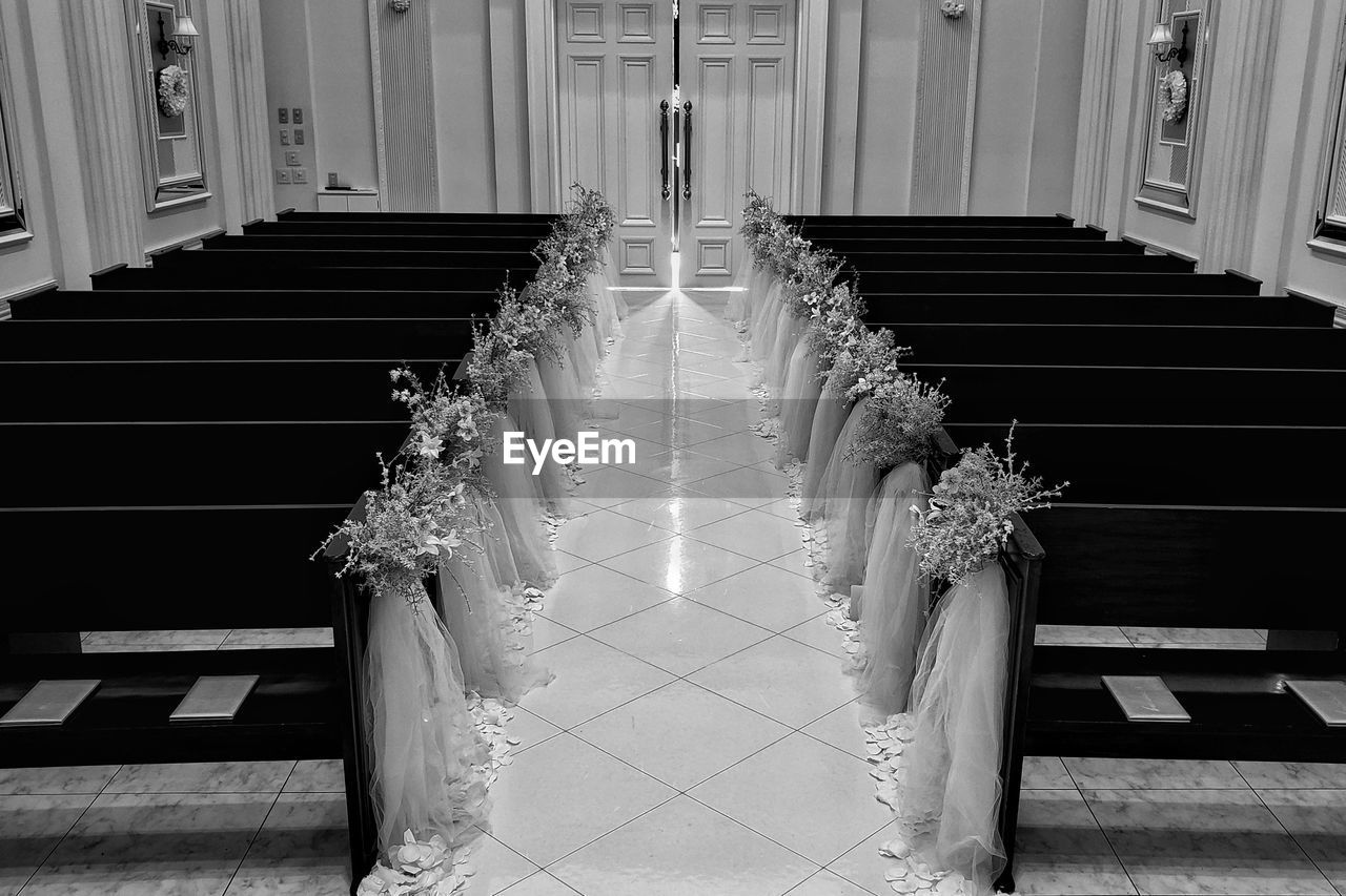architecture, staircase, celebration, indoors, wedding, steps and staircases, railing, event, no people, life events, built structure, religion, wedding dress, building, belief, flower, the way forward, direction, bouquet, flower arrangement