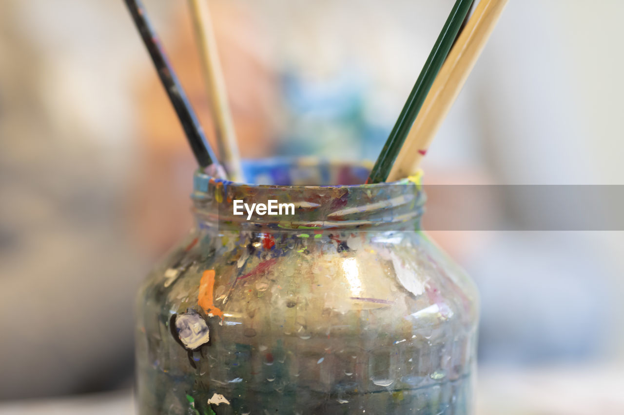 close-up, container, focus on foreground, glass - material, jar, indoors, transparent, no people, bottle, still life, selective focus, day, straw, drinking straw, nature, choice, variation, food and drink