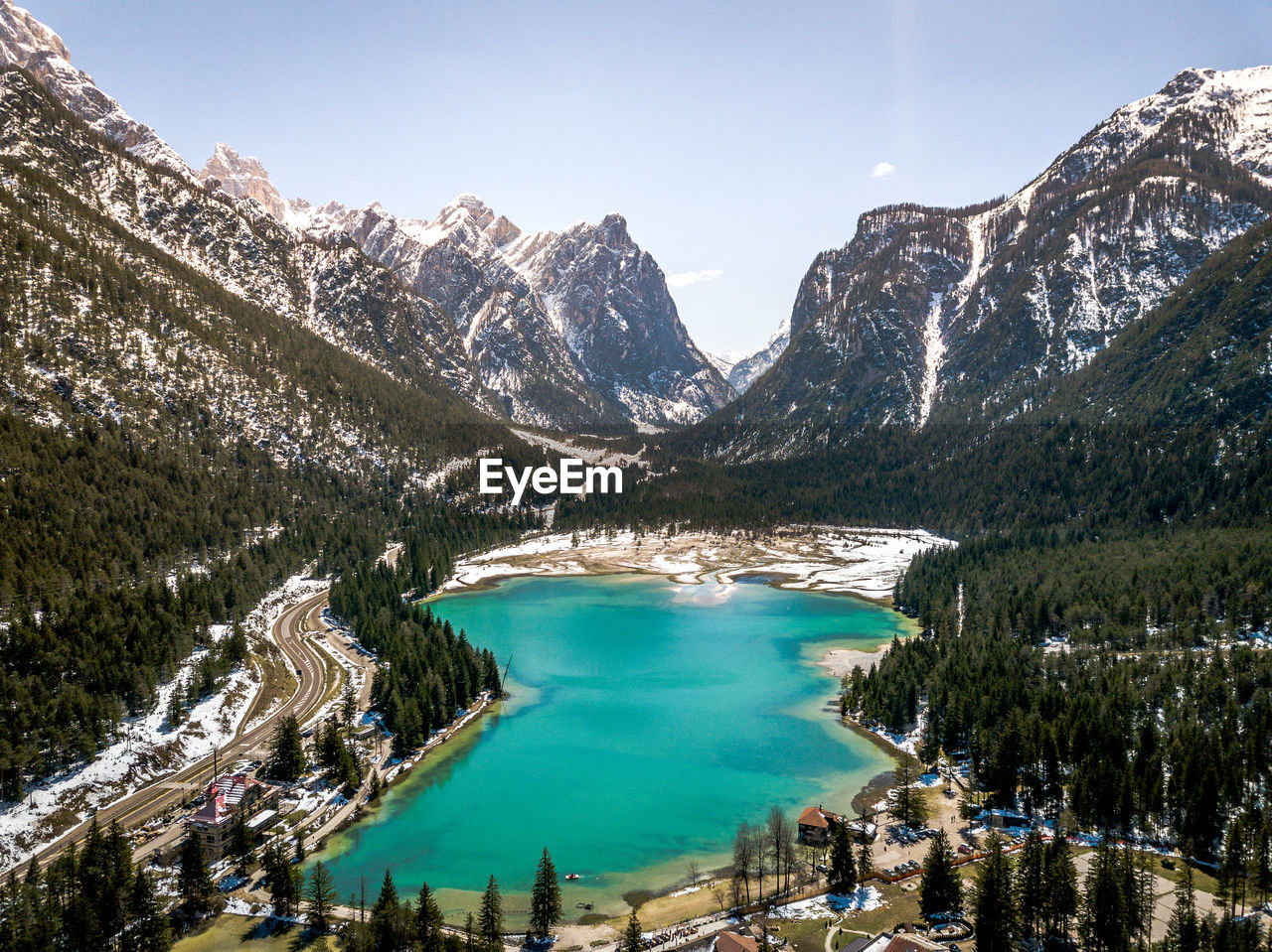 mountain, water, beauty in nature, scenics - nature, sky, lake, nature, plant, tree, winter, day, snow, tranquil scene, cold temperature, tranquility, non-urban scene, mountain range, travel, environment, outdoors, turquoise colored, snowcapped mountain