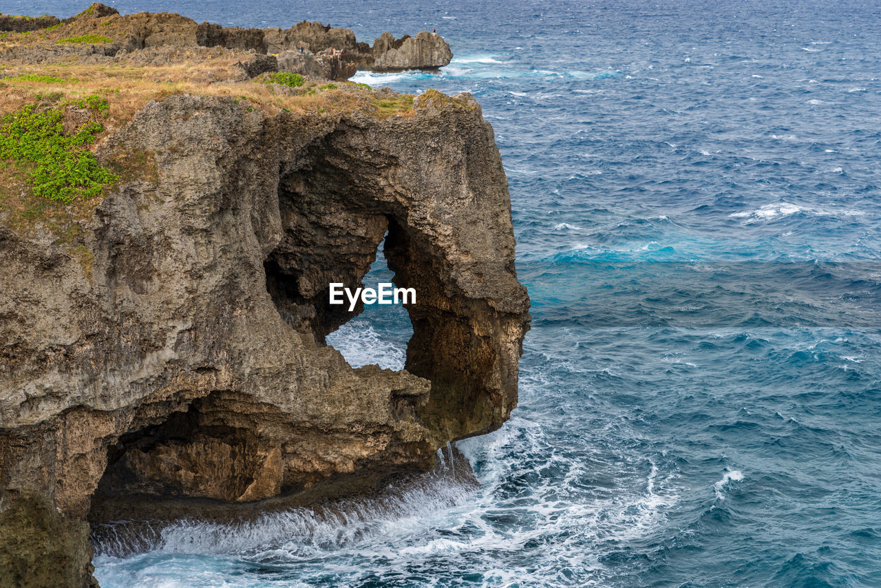 sea, water, rock, solid, rock - object, rock formation, no people, day, nature, beauty in nature, motion, scenics - nature, land, tranquility, blue, outdoors, tranquil scene, non-urban scene, geology, eroded, rocky coastline