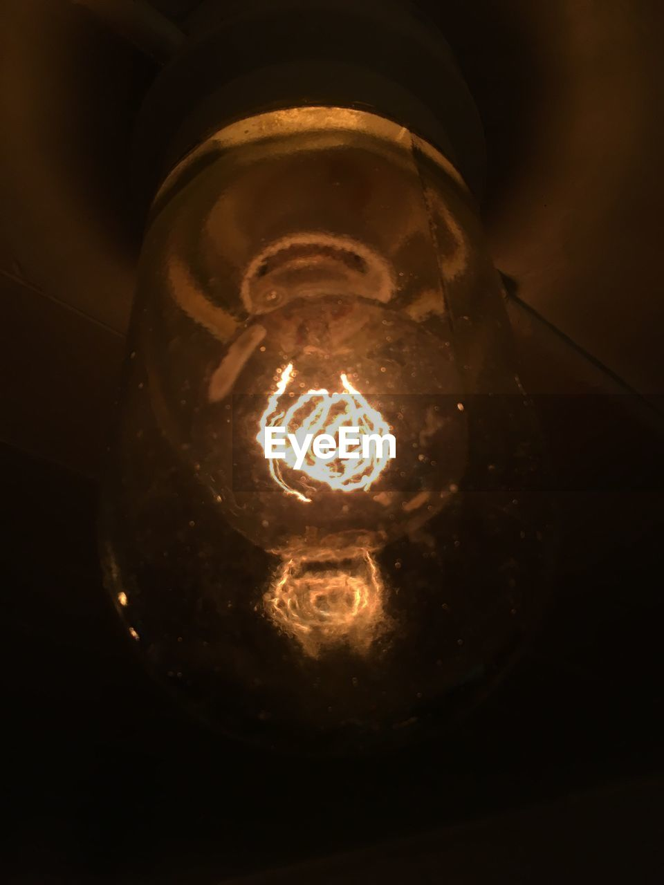 electricity, light bulb, lighting equipment, illuminated, no people, close-up, filament, low angle view, technology, indoors, black background
