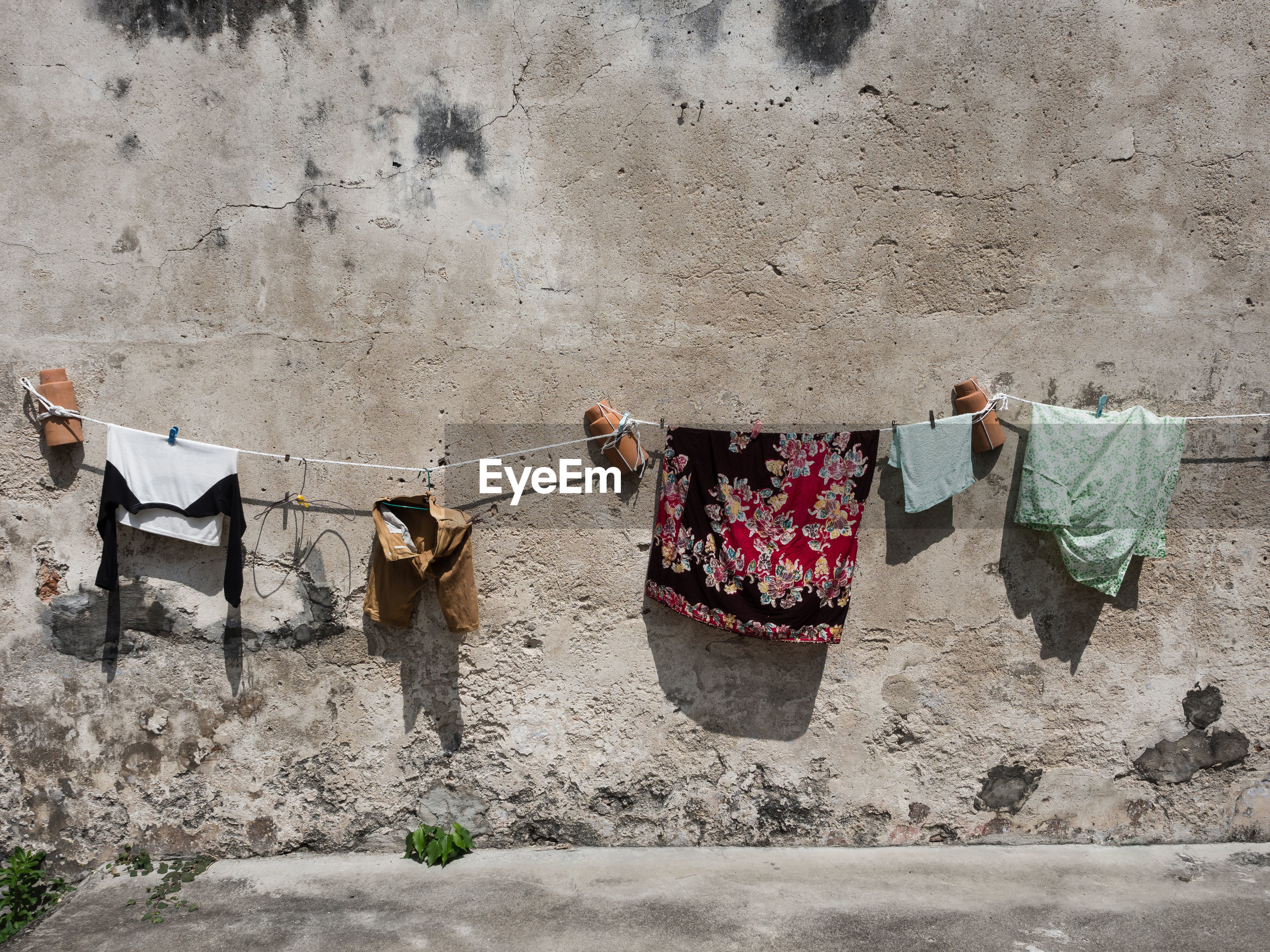 Clothes drying on wall
