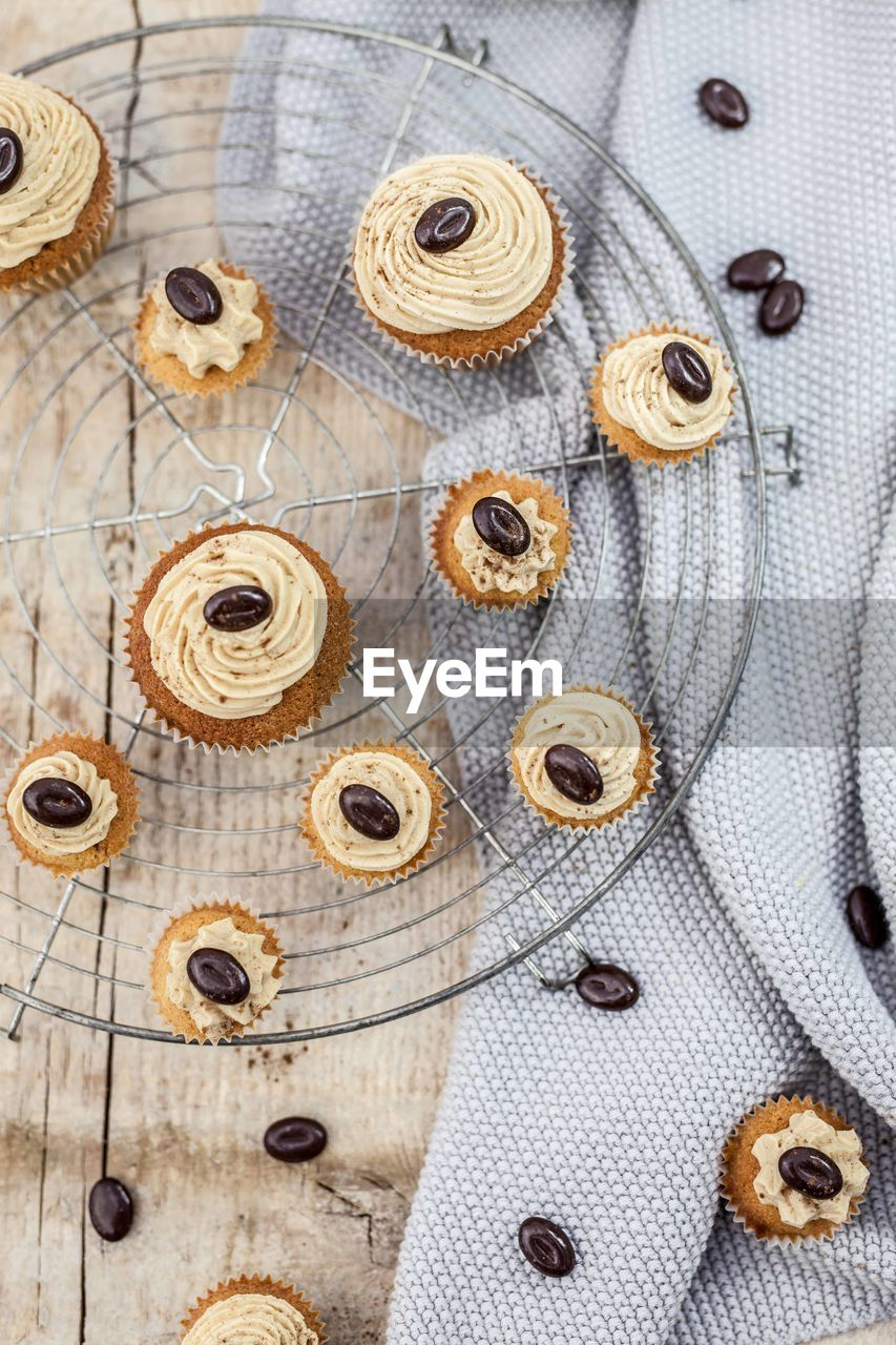 Close-up of cupcakes on wooden table