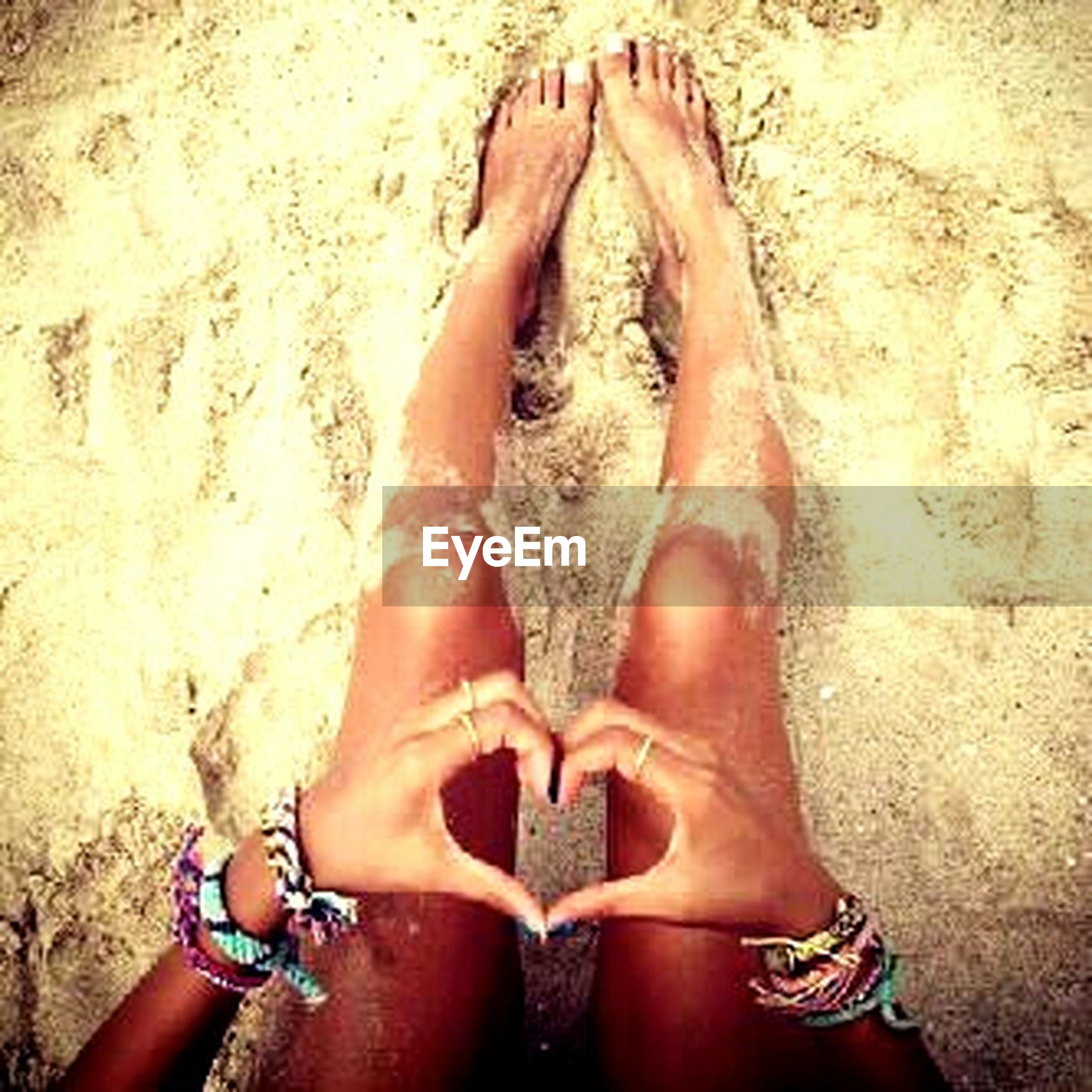 low section, person, barefoot, lifestyles, human foot, beach, leisure activity, high angle view, sand, personal perspective, relaxation, standing, water, day, outdoors, sitting
