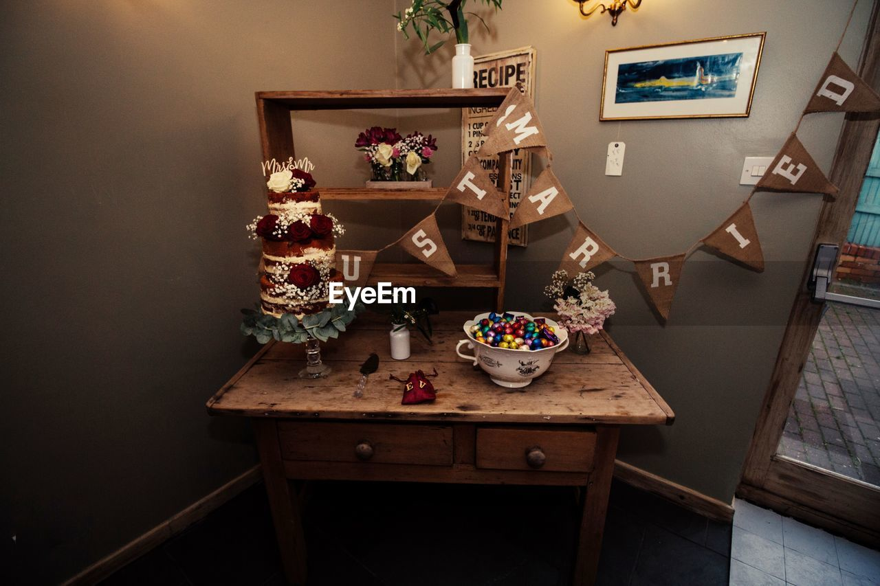 indoors, wood - material, picture frame, no people, home interior, table, shelf, home showcase interior, day, close-up