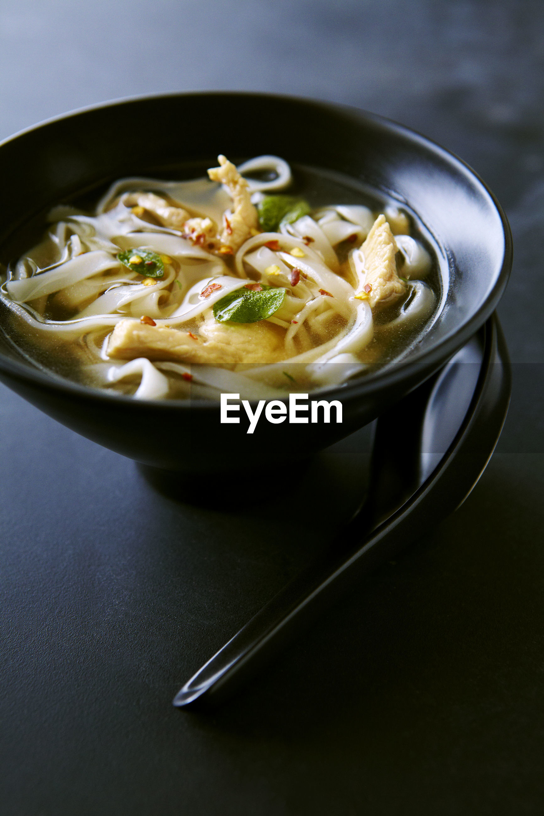 CLOSE-UP OF SOUP IN BOWL ON TABLE
