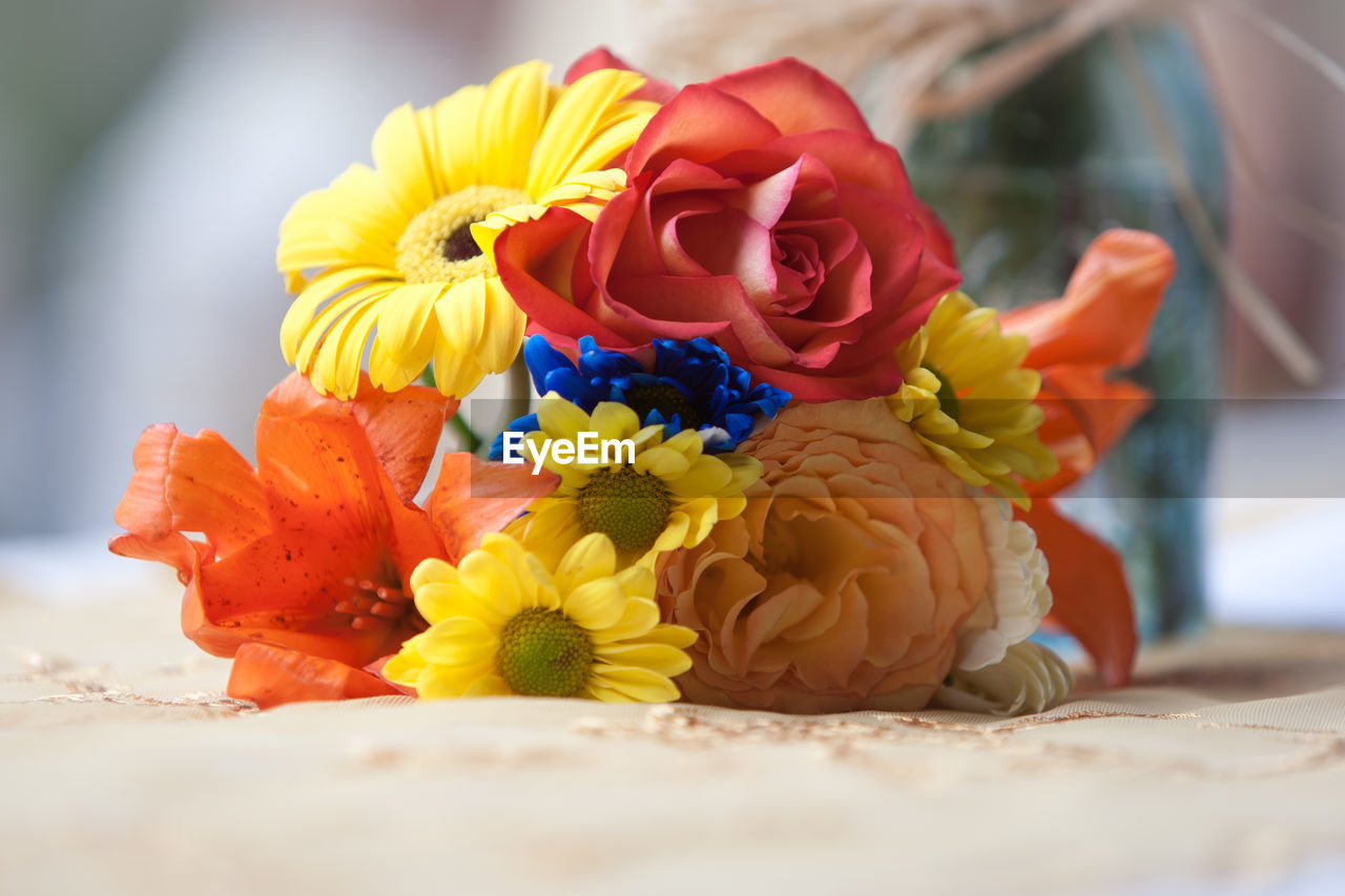 Bouquet Of Colorful Flowers On Tablecloth