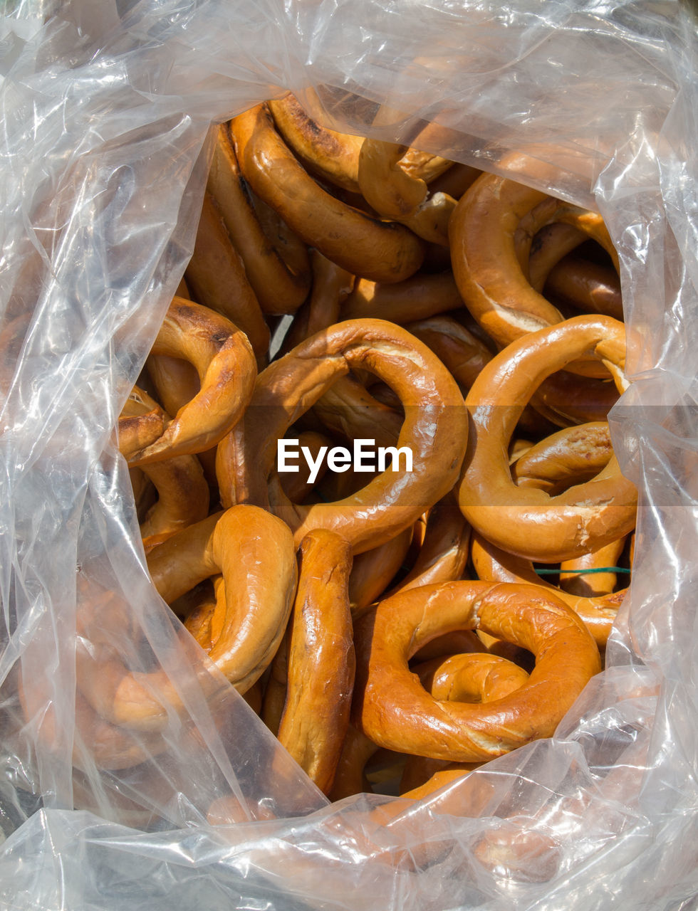 food, food and drink, freshness, bag, plastic, still life, plastic bag, no people, snack, high angle view, pretzel, indoors, large group of objects, transparent, ready-to-eat, for sale, close-up, unhealthy eating, retail, abundance, salted, polythene
