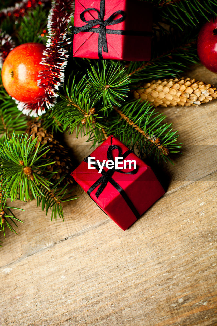 holiday, decoration, christmas, christmas decoration, celebration, christmas tree, red, christmas ornament, indoors, tree, no people, table, still life, gift, green color, high angle view, celebration event, holiday - event, close-up, gift box, box - container