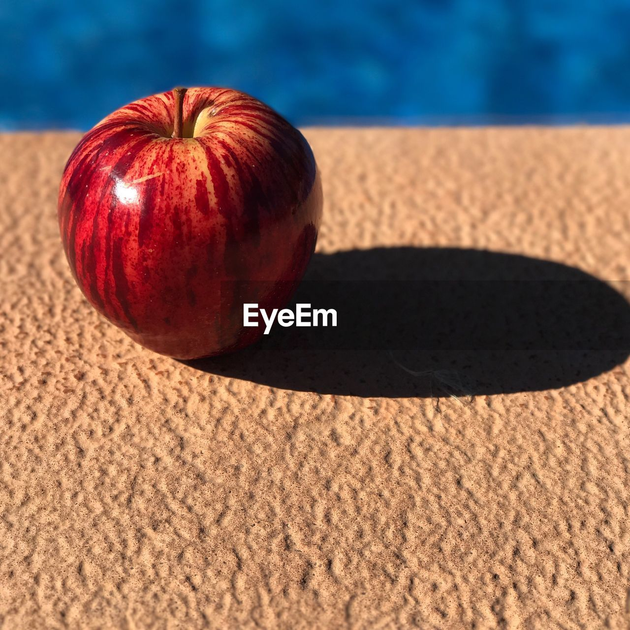 food, wellbeing, food and drink, fruit, healthy eating, freshness, no people, still life, red, indoors, close-up, sunlight, shadow, focus on foreground, table, nature, single object, day, high angle view, carpet - decor, ripe