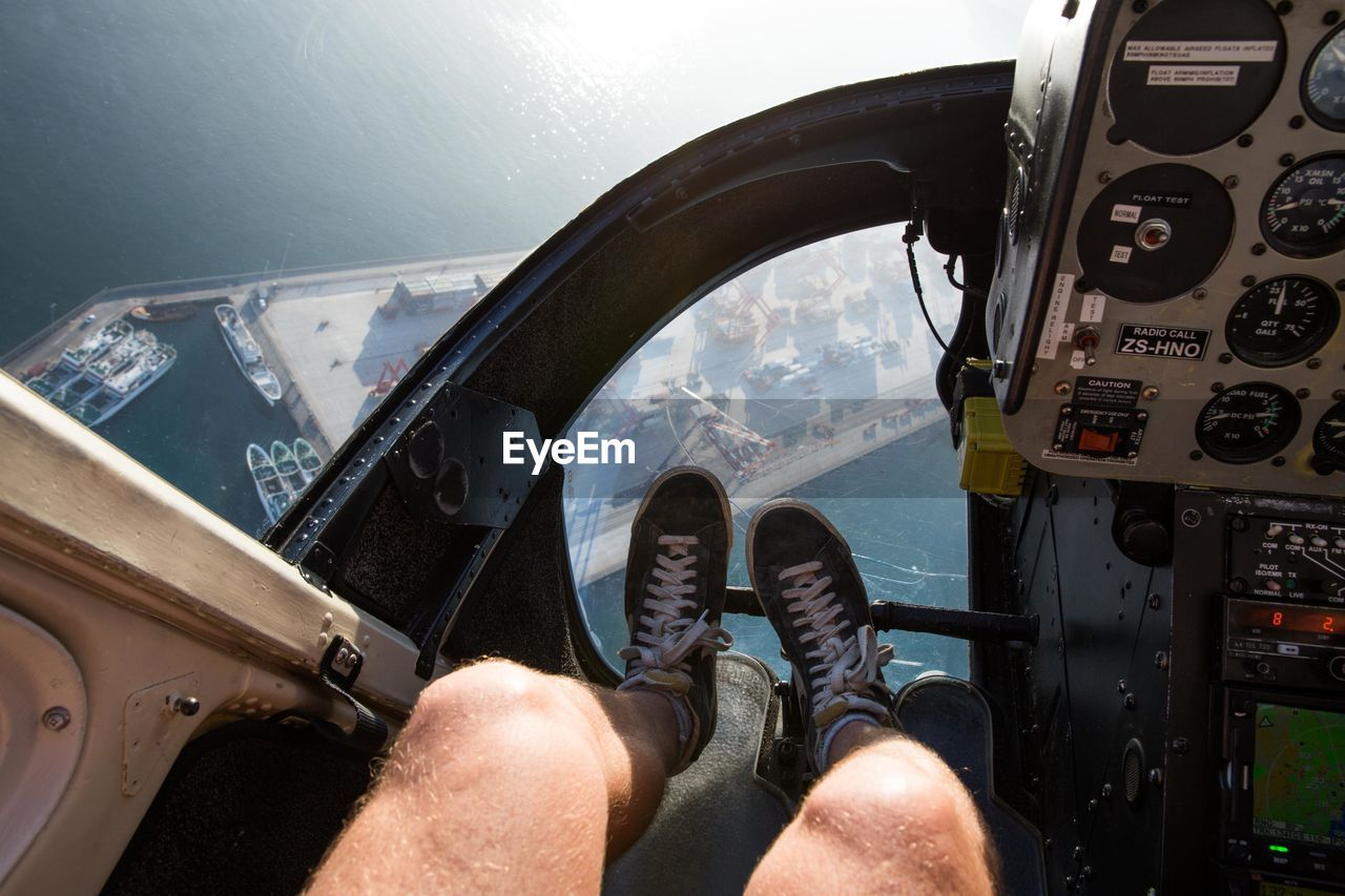 Low Section Of Man Sitting In Helicopter