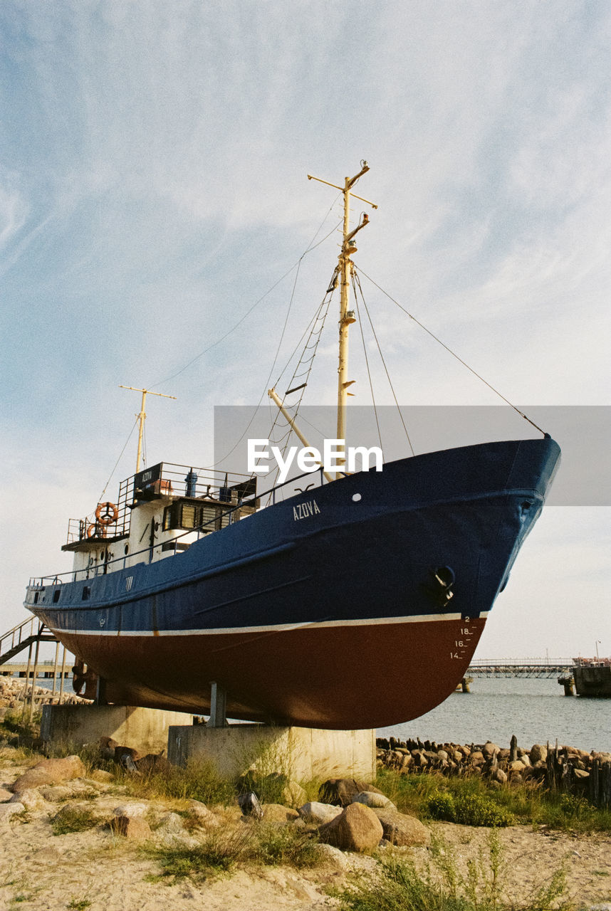 nautical vessel, sky, transportation, mode of transportation, water, cloud - sky, nature, sea, day, no people, land, beach, moored, ship, outdoors, tranquility, sailboat, architecture, built structure