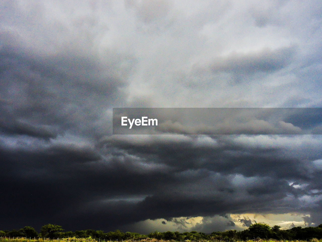 cloud - sky, weather, storm cloud, storm, sky, dramatic sky, nature, cloudscape, beauty in nature, scenics, atmospheric mood, thunderstorm, ominous, majestic, no people, tranquility, outdoors, sky only, low angle view, landscape, tornado, day, power in nature, tree, lightning, forked lightning