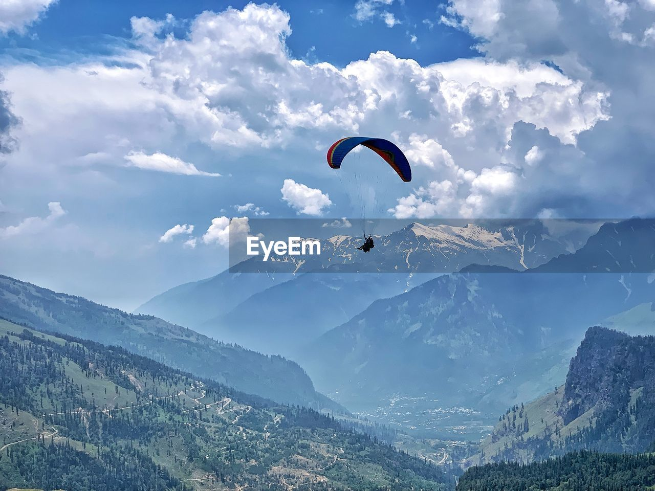 adventure, mountain, sport, extreme sports, parachute, paragliding, flying, beauty in nature, unrecognizable person, mid-air, leisure activity, sky, mountain range, scenics - nature, freedom, cloud - sky, day, real people, one person, lifestyles, outdoors