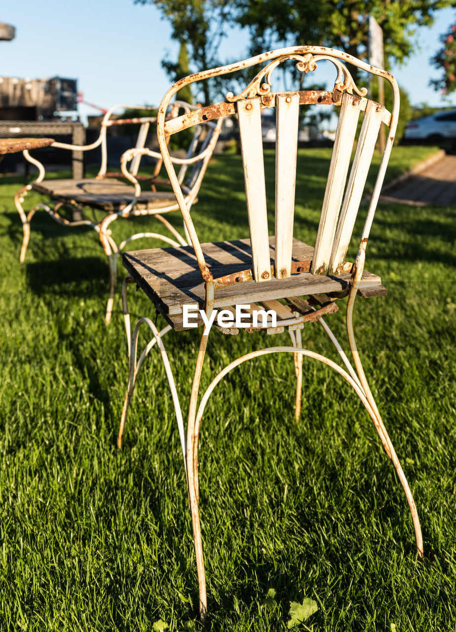 Tables and chairs arranged on grassy field