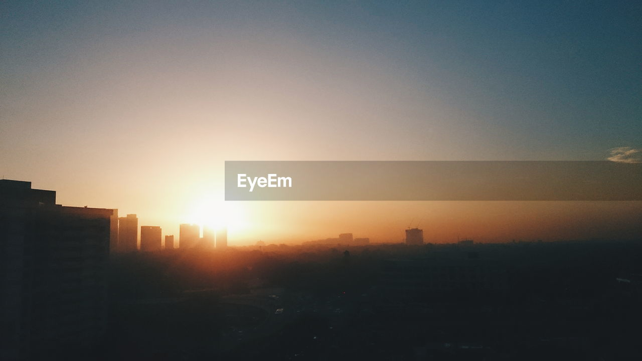 sunset, sun, architecture, cityscape, sunlight, city, skyscraper, no people, building exterior, silhouette, sky, outdoors, clear sky, modern, nature, day