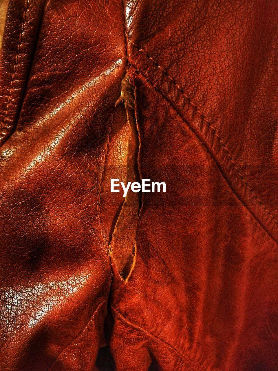 Full frame shot of torn leather jacket