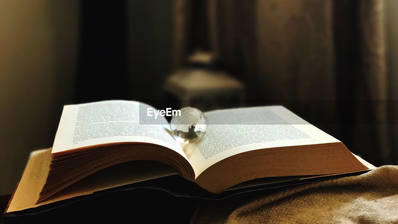 book, publication, education, open, indoors, page, still life, close-up, focus on foreground, expertise, paper, learning, literature, reading, people, table, wisdom, religion, studying
