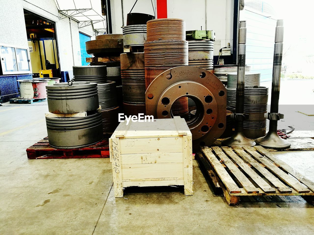 indoors, stack, workshop, industry, wood - material, spool, no people, manufacturing equipment, factory, day