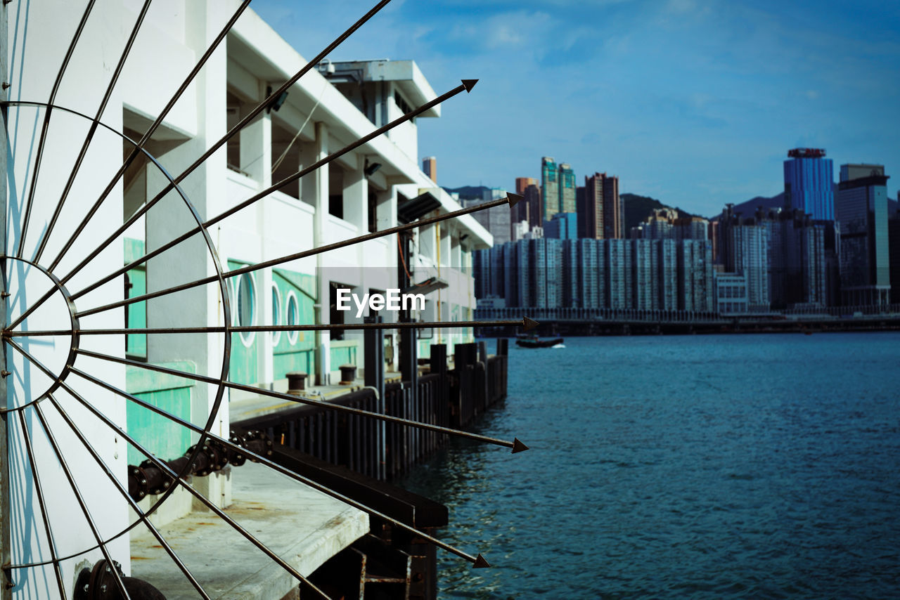 architecture, built structure, building exterior, water, sky, city, building, nature, day, no people, modern, outdoors, waterfront, office building exterior, travel destinations, sea, cloud - sky, skyscraper, transportation, luxury