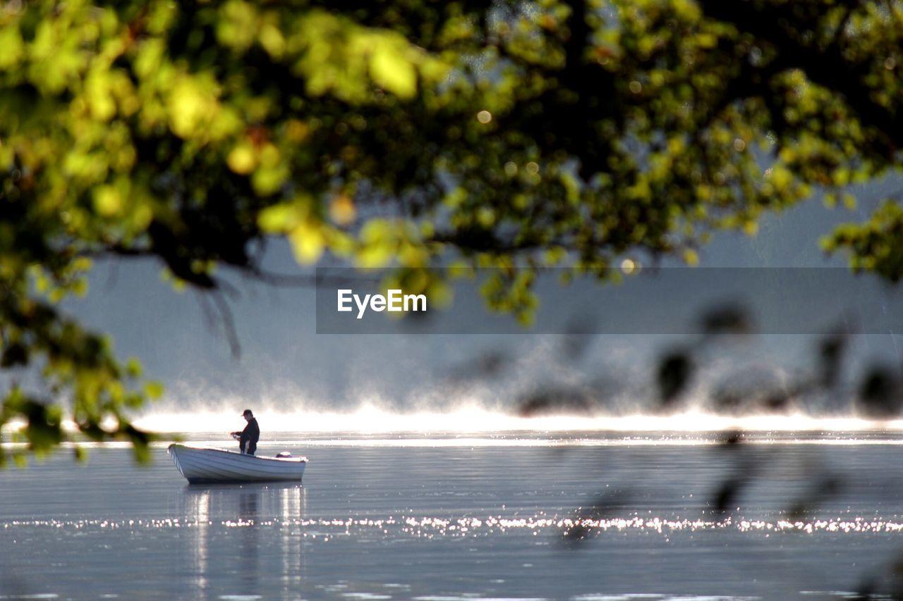 Man in boat fishing