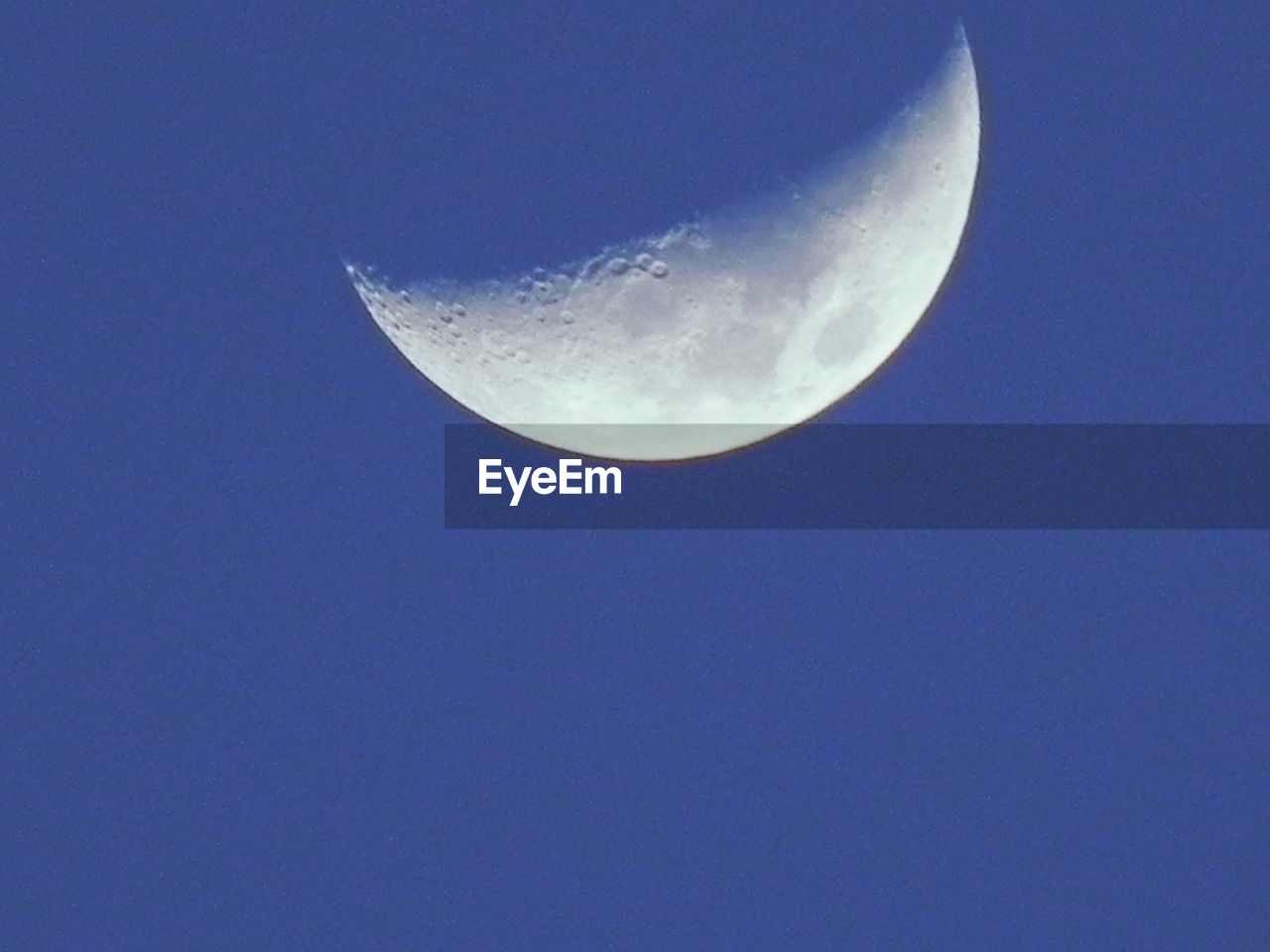 moon, astronomy, half moon, moon surface, clear sky, planetary moon, night, low angle view, beauty in nature, nature, crescent, copy space, tranquility, tranquil scene, scenics, outdoors, sky, space exploration, blue, no people, sky only, space