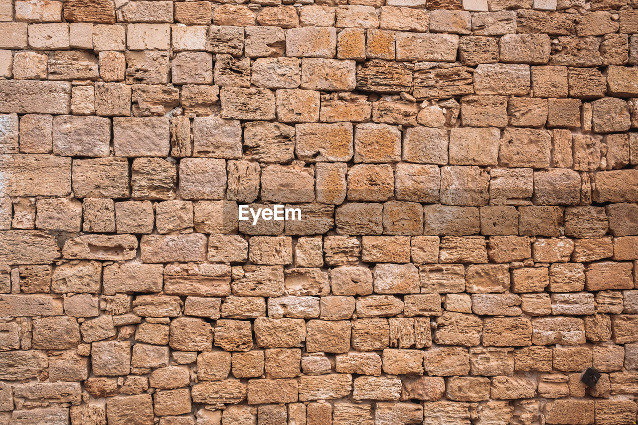 full frame, backgrounds, architecture, textured, brown, pattern, no people, wall, built structure, close-up, in a row, outdoors, solid, nature, brick, ancient, day, wall - building feature, construction material, construction industry, stone wall, antique, textured effect, abstract backgrounds