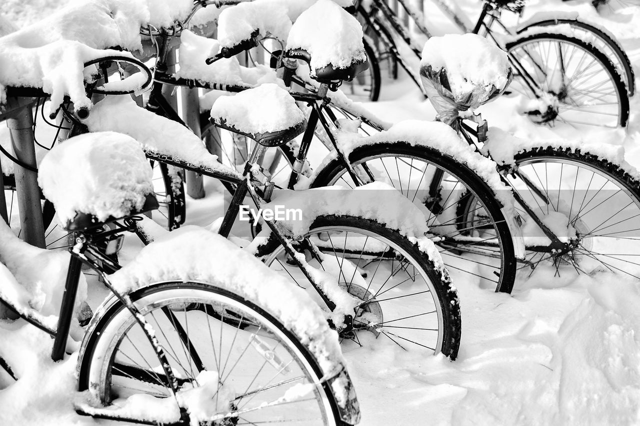 High Angle View Of Snow On Bicycles