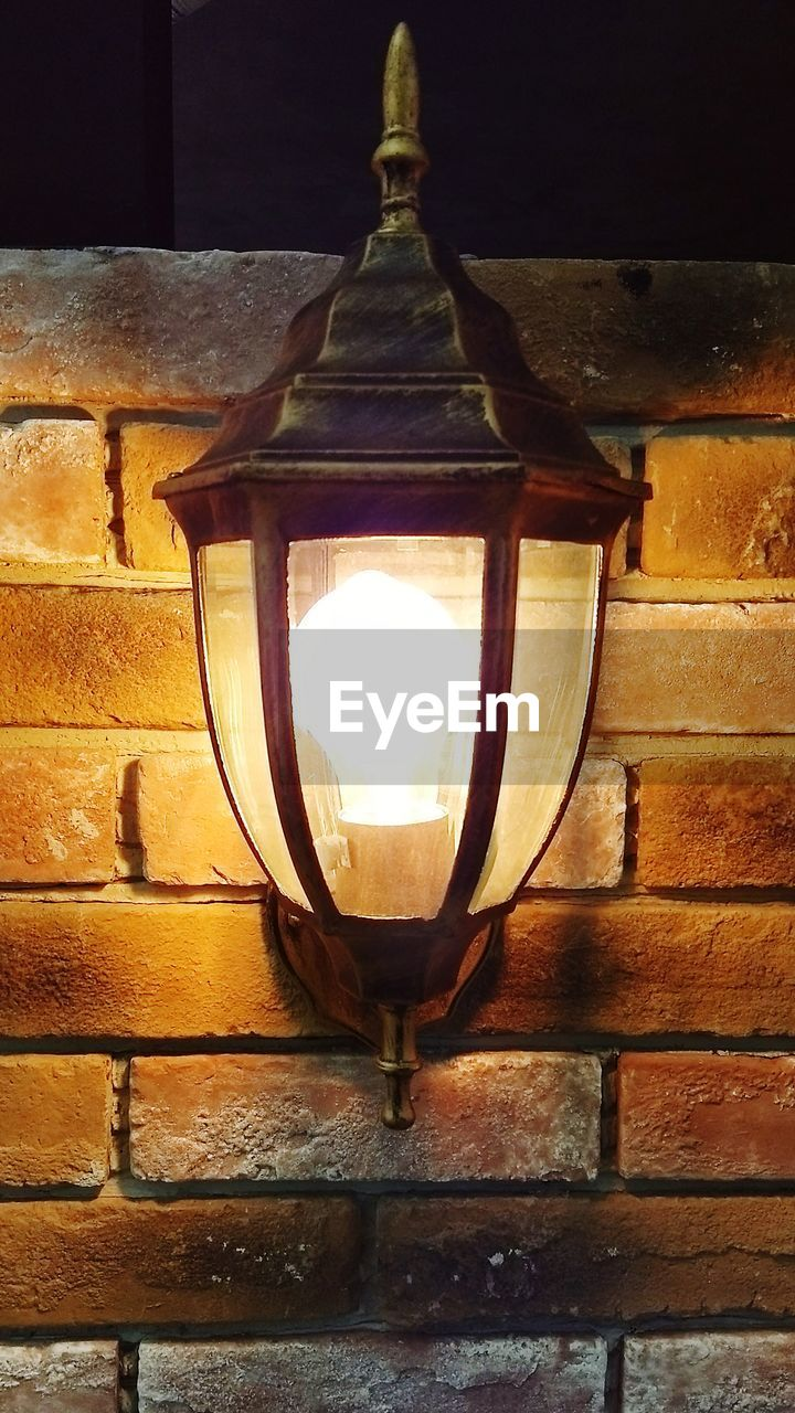 lighting equipment, illuminated, no people, electric light, brick wall, lantern, indoors, close-up, architecture, day