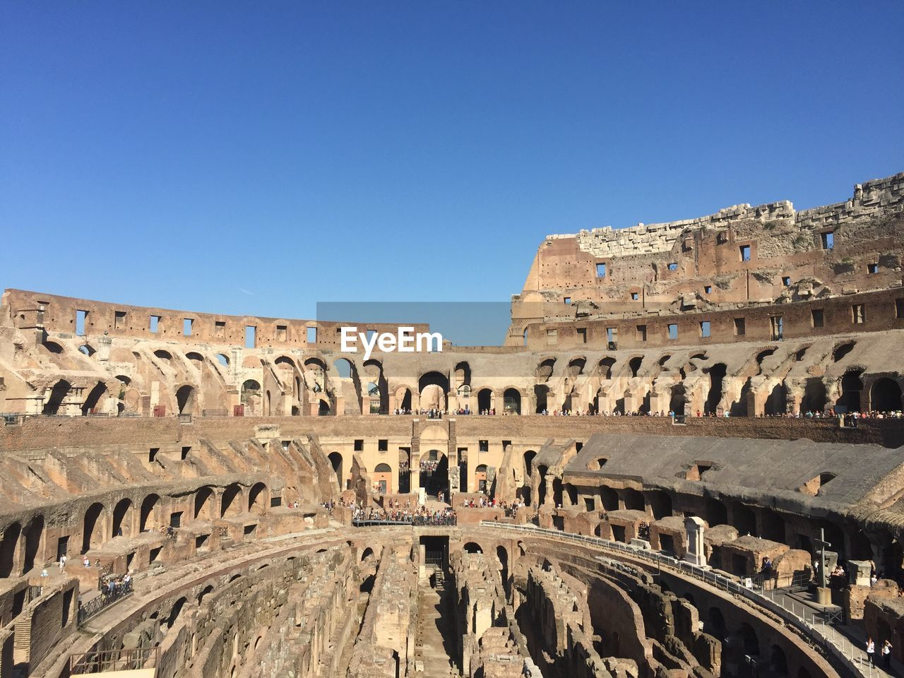 architecture, sky, history, clear sky, the past, built structure, ancient, travel destinations, tourism, building exterior, copy space, travel, amphitheater, arch, day, nature, old ruin, blue, arts culture and entertainment, ancient civilization, archaeology, outdoors, ruined