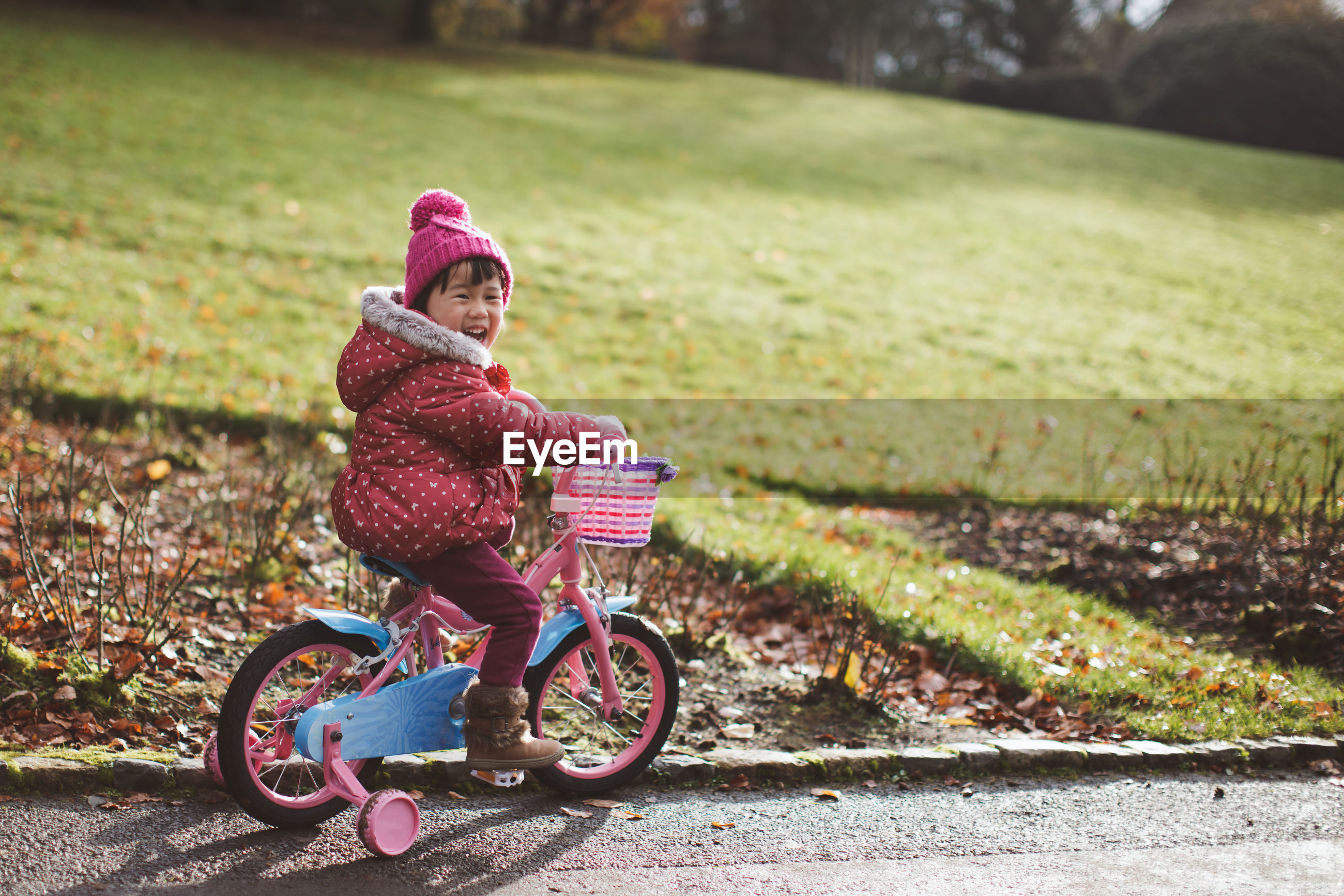 Portrait of girl riding bicycle on road