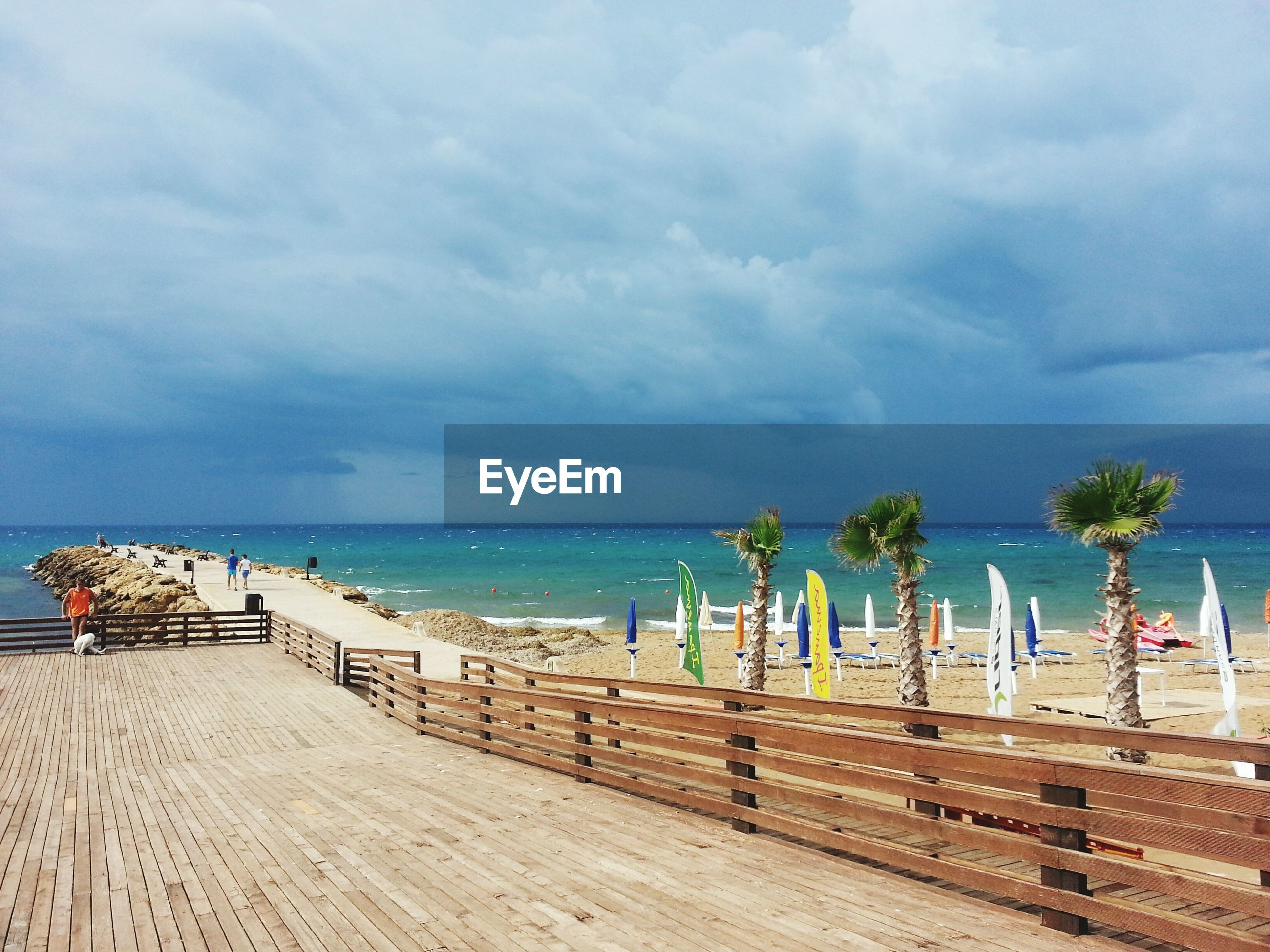 sea, beach, horizon over water, sky, sand, water, shore, tranquility, tranquil scene, scenics, beauty in nature, cloud - sky, nature, incidental people, pier, vacations, idyllic, cloudy, cloud, tourism