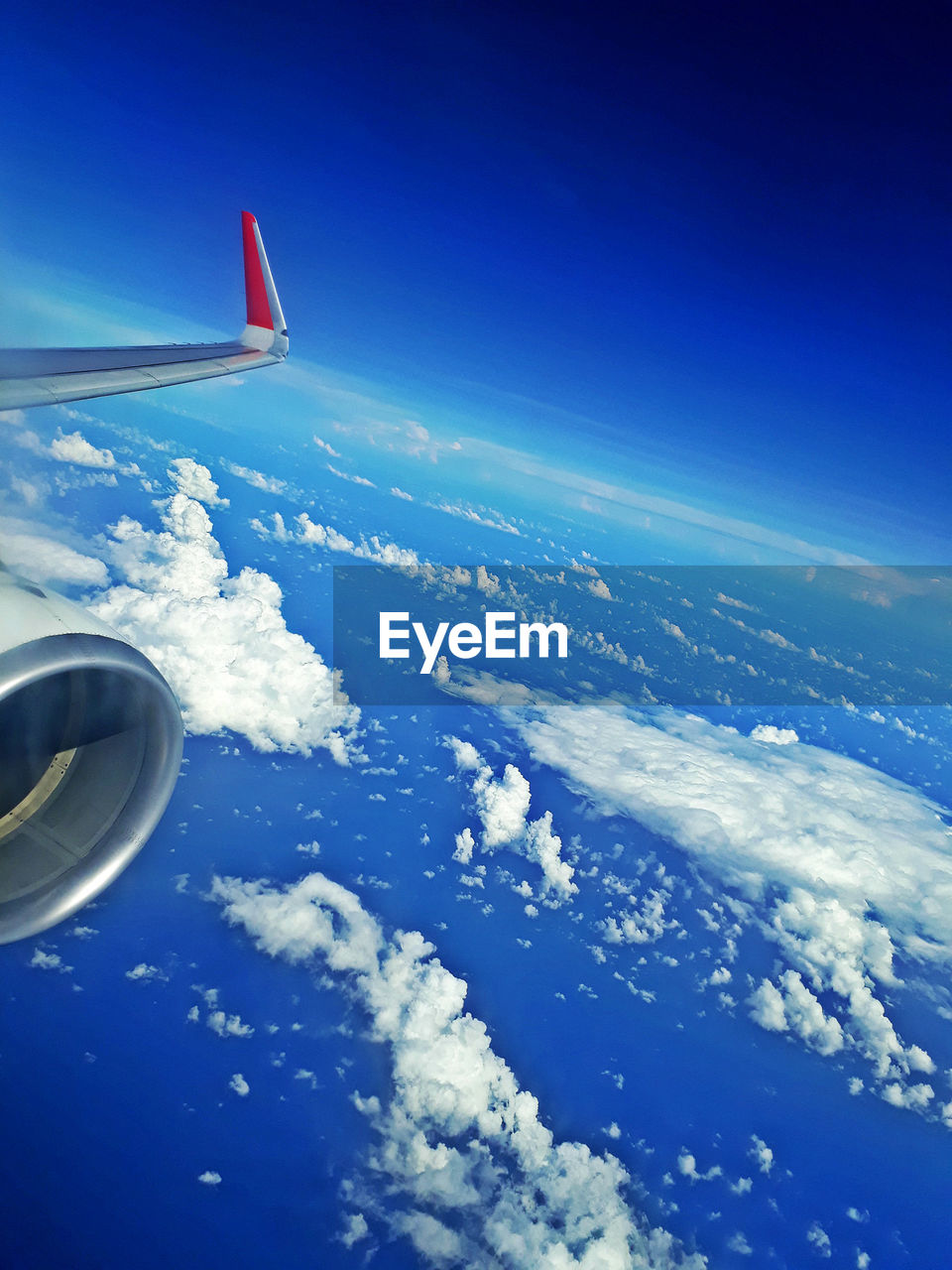 airplane, air vehicle, cloud - sky, flying, sky, mode of transportation, transportation, aerial view, blue, scenics - nature, travel, aircraft wing, beauty in nature, motion, no people, on the move, mid-air, nature, journey, engine, jet engine, outdoors