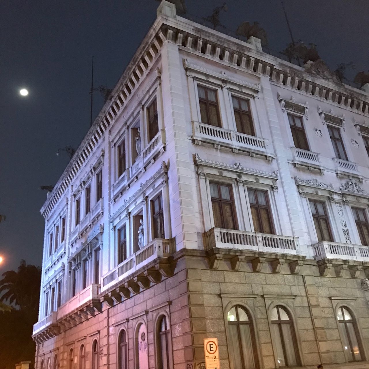 building exterior, architecture, built structure, low angle view, window, building, illuminated, night, no people, city, sky, outdoors, street, history, nature, lighting equipment, moon, arch, the past, street light