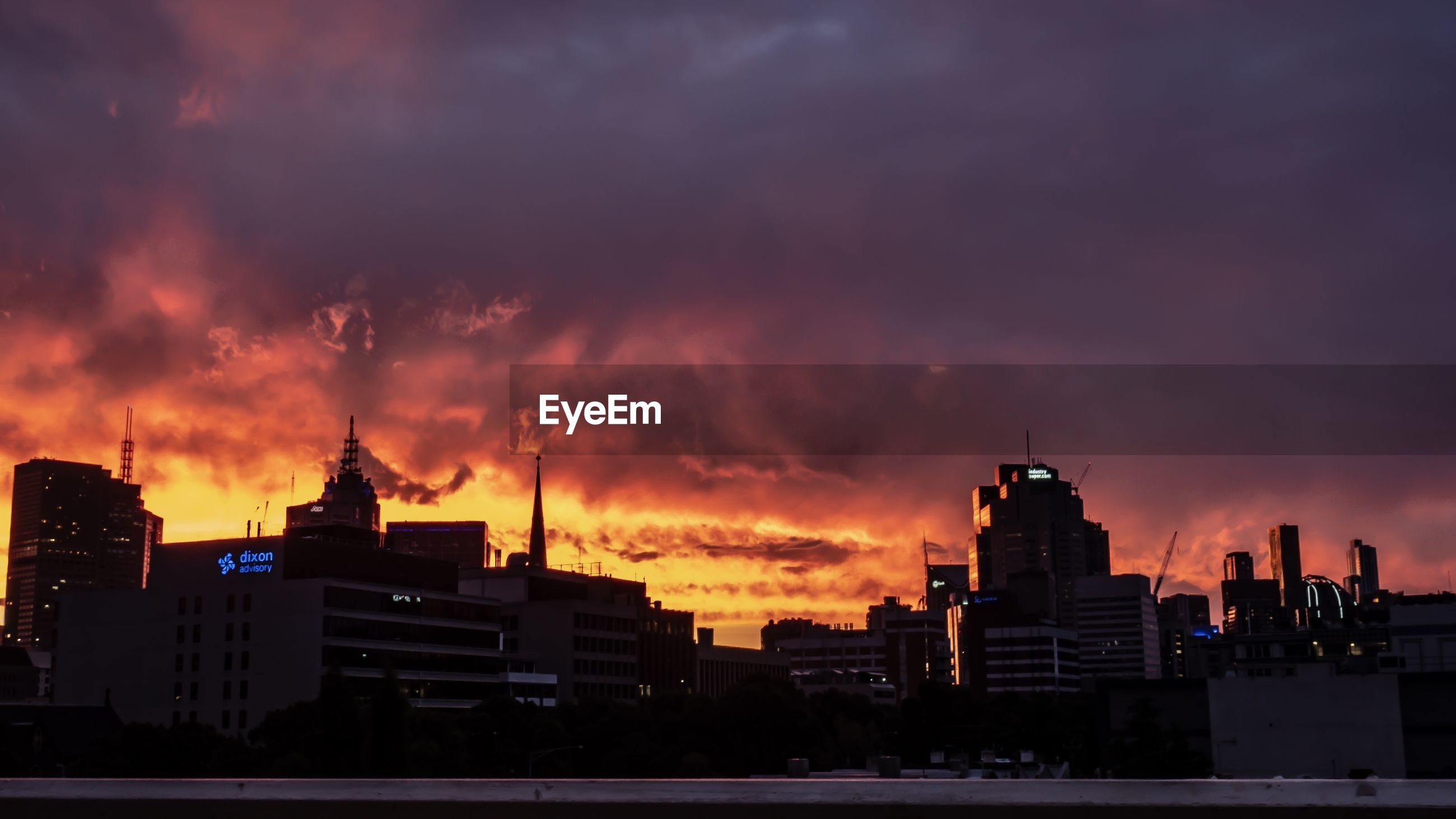SILHOUETTE BUILDINGS AGAINST DRAMATIC SKY