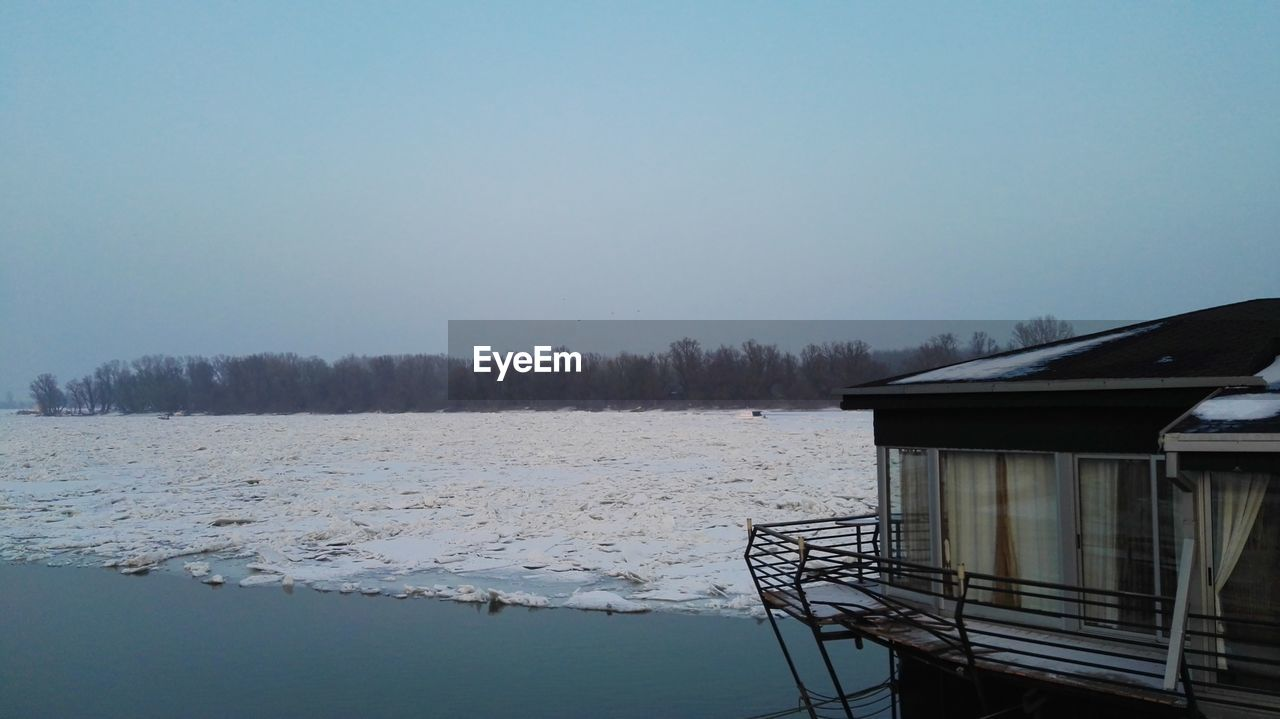 water, sky, architecture, built structure, cold temperature, nature, no people, clear sky, building exterior, copy space, scenics - nature, tranquility, tranquil scene, beauty in nature, winter, tree, day, lake, outdoors