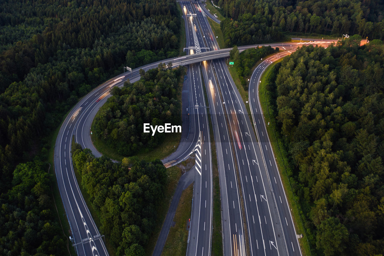 High angle view of highway amidst trees in city