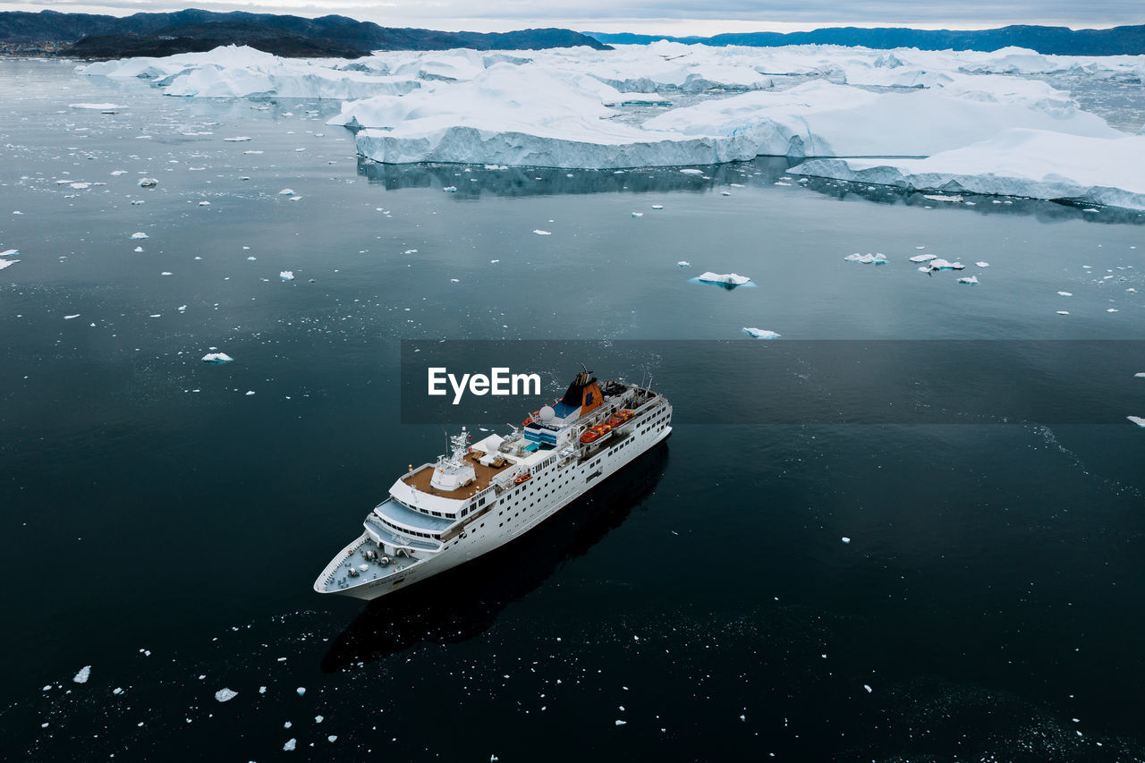High angle view of nautical vessel on sea during winter