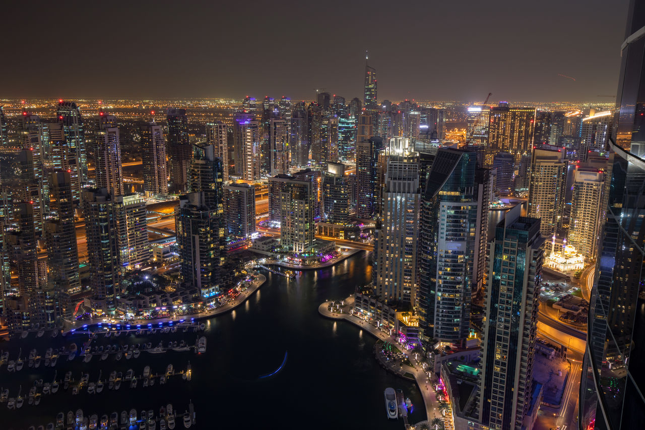 building exterior, city, architecture, cityscape, built structure, illuminated, office building exterior, skyscraper, tall - high, building, night, sky, modern, tower, crowd, urban skyline, crowded, office, water, financial district, outdoors, nightlife